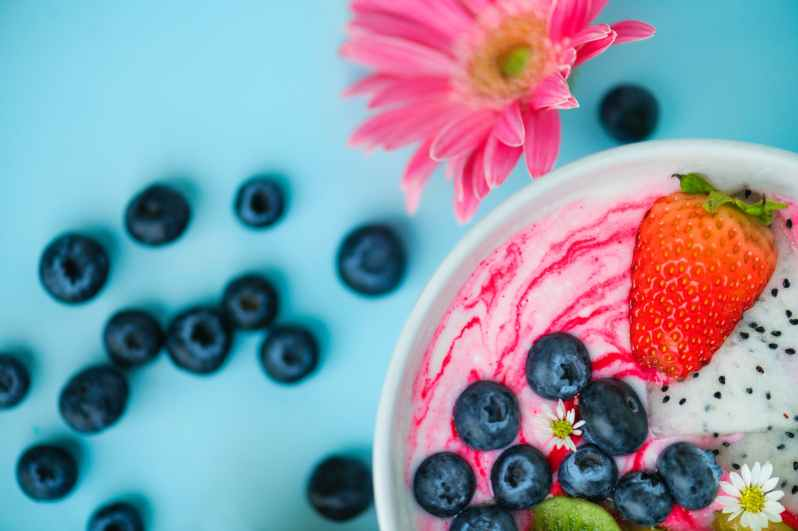 photo of white bowl filled with berries